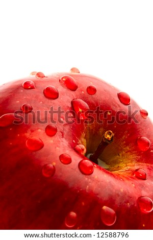 ripe red apple in drop of water - stock photo