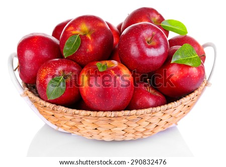 Ripe red apple in wicker basket isolated on white - stock photo