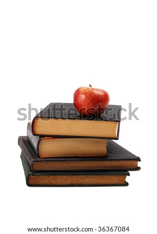 Ripe red apple on a book pile. Isolated on white background