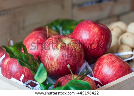 Ripe red apples in wood box. - stock photo
