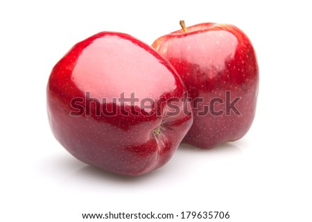 ripe red apples on a white background with shadow