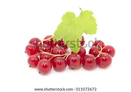 Ripe red currants close up isolated on white - stock photo