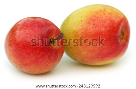 Ripe red juicy jujube fruits over white background