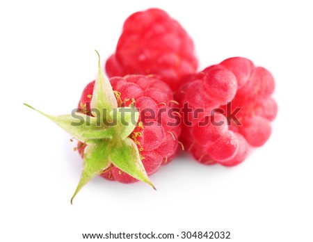 Ripe red raspberries isolated on white