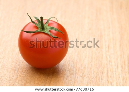 Ripe red tomato on the wood