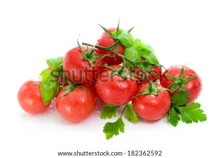 Ripe red tomatoes, basil  and  parsley, - stock photo