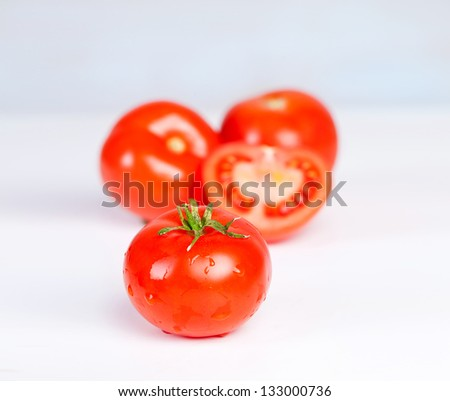 ripe red tomatoes on white background - stock photo