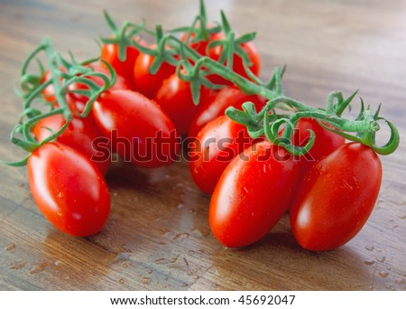 Ripe red tomatoes with selected focus - stock photo
