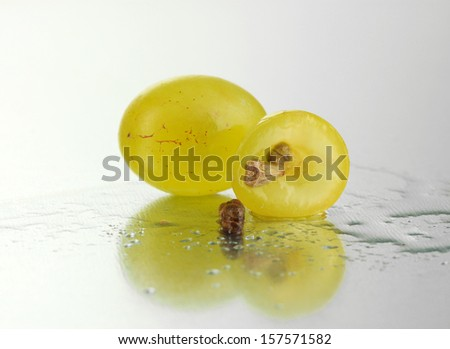Ripe sliced grape and seeds, close up - stock photo