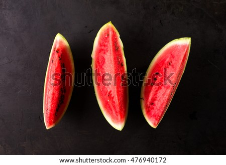 ripe sliced watermelon. Black background. view from above