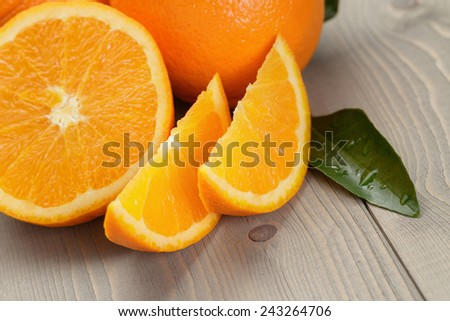 ripe spanish oranges on wood table, rustic photo - stock photo
