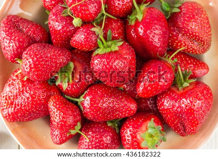 Ripe strawberries on a wooden background. Healthy eating