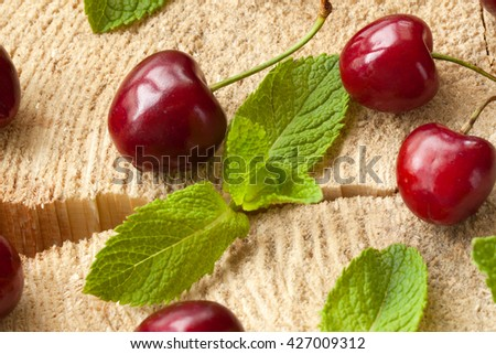 Ripe sweet cherry with water drops on stump - stock photo