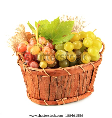Ripe sweet grape in basket, isolated on white - stock photo