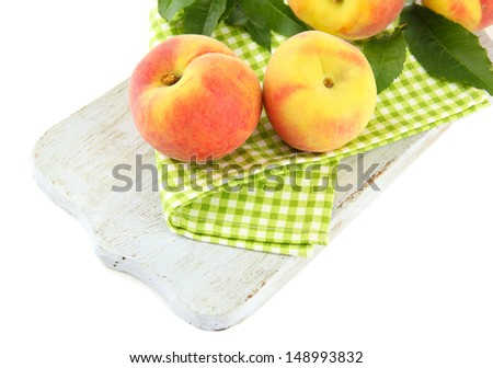 Ripe sweet peaches, isolated on white