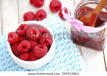Ripe sweet raspberries in bowl - stock photo