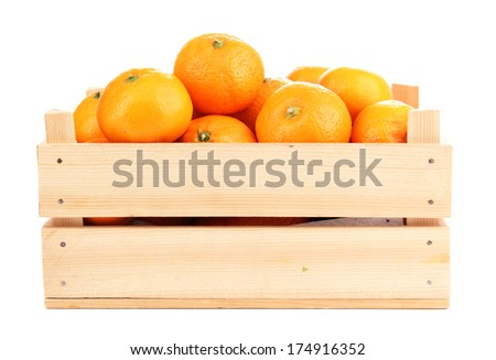 Ripe sweet tangerines in wooden box, isolated on white - stock photo