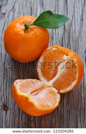 Ripe sweet tangerines on an old wooden background.