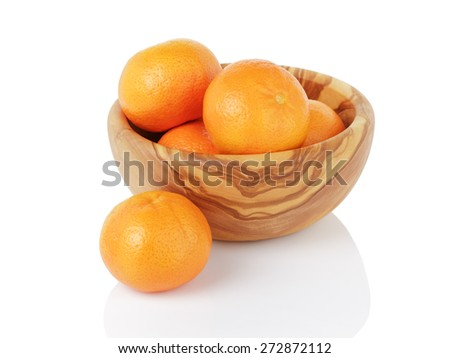 ripe tangerines in wood bowl, isolated on white - stock photo