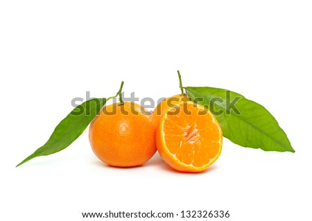 Ripe  tangerines (mandarin) with half and green leaf isolated on white - stock photo