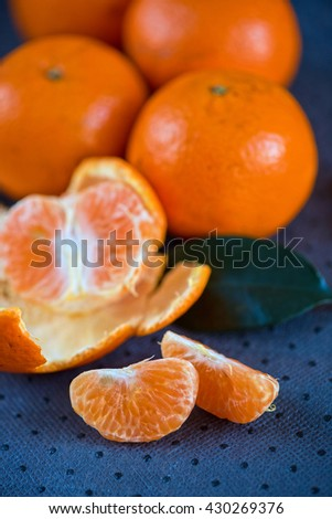 Ripe tangerines on wooden background - stock photo