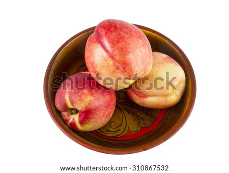Ripe tasty peach in a wooden plate on white  - stock photo