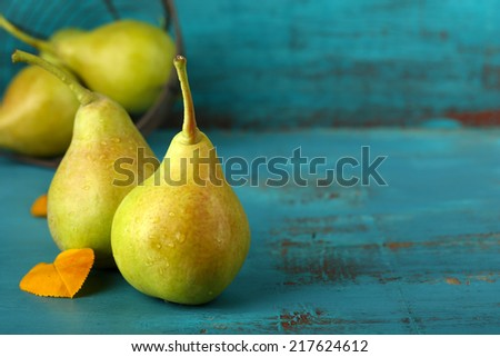 Ripe tasty pears on wooden table - stock photo