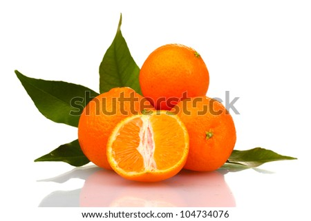 Ripe tasty tangerines with leaves and segments isolated on white - stock photo