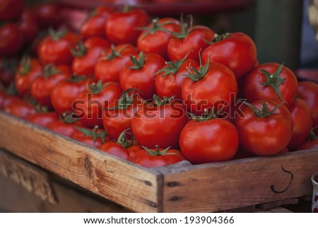 Ripe tomatoes at a farmer's market - stock photo