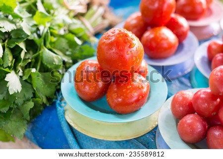 Ripe tomatoes at a farmer's market - stock photo