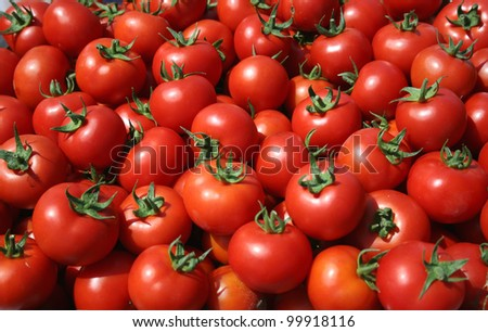 Ripe tomatoes at the market - stock photo