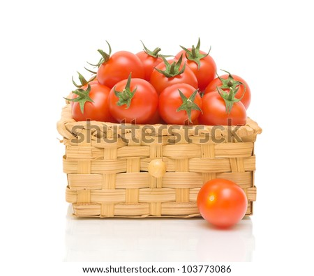 ripe tomatoes in a wicker basket isolated on white close-up of the reflection - stock photo