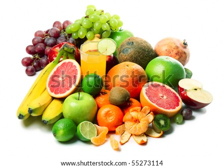Ripe tropical fruits and slices and glass with juice - stock photo