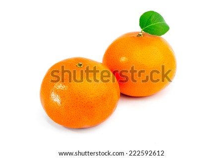 Ripe two tangerines (mandarin) with green leaf isolated on white. - stock photo