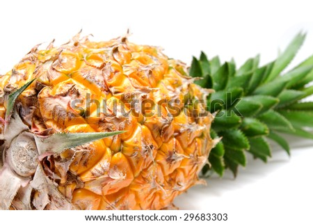 ripe vivid pineapple close up over white background