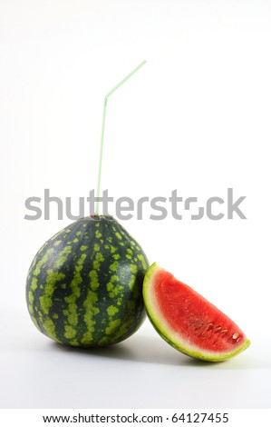 Ripe watermelon with a tubule for cocktails