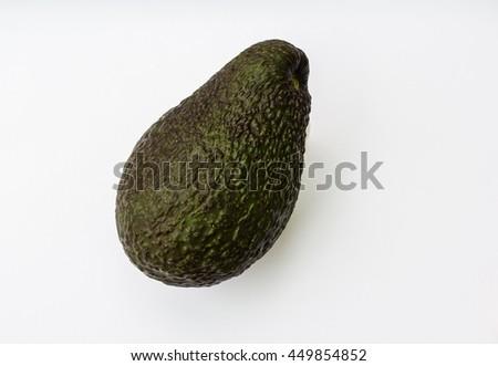 ripe whole avocado on white background - stock photo