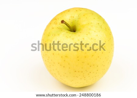 Ripe yellow apple on white background