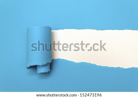 Ripped blue paper with space for text - stock photo