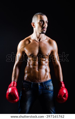 Ripped boxer in sports concept - stock photo