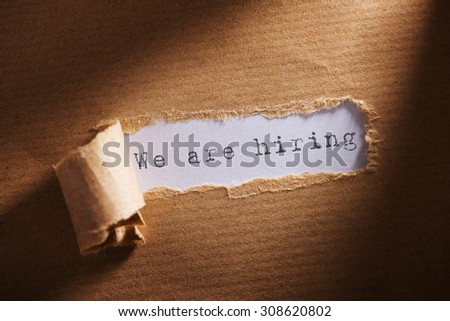 ripped paper with word we are hiring - stock photo