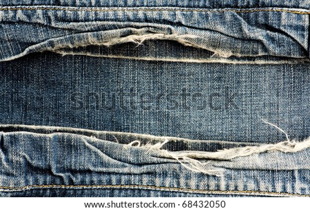 ripped vintage jeans - stock photo