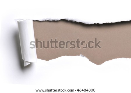 ripped white paper against a brown background - stock photo