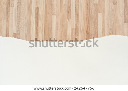 Ripped white paper on wooden pattern background. - stock photo