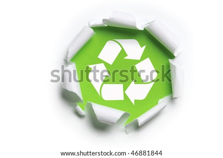 ripped white paper with recycle logo against a green background - stock photo