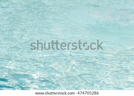 Ripple wave of clean and clear blue water in swimming pool.
