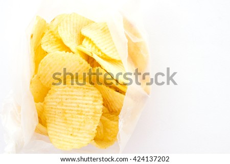 Rippled potato chips on wax paper