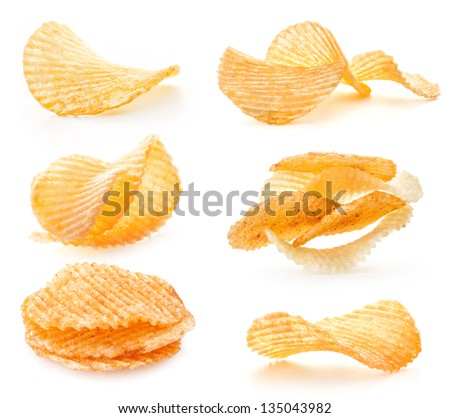 Rippled potato chips with pepper isolated on white background - stock photo