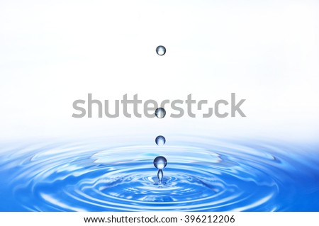 ripples and water droplets - stock photo