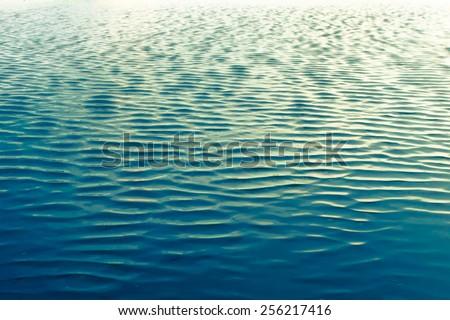 Ripples in ocean water - stock photo